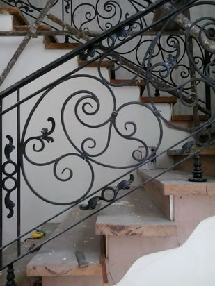Wrought Iron Stair Railing, Entrance Gate, and False Balcony Railing