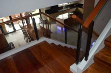 Glass Modern Stair Railing in Wrought Iron Frame
